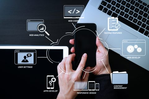 Developing programming and coding technologies with Website design in virtual diagram.cyber security internet and networking concept.Businessman hand working with mobile phone on laptop computer background